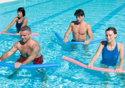 Aquagym exercises with colored tubes